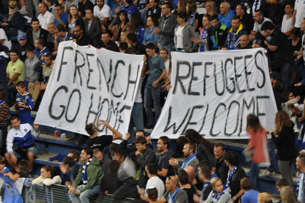 "In Furiani : ""French go home - refugees welcome"""