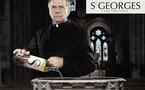 St Georges face a so pubba cun l'abbé vide-eau